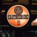 8 Wired 'Tall Poppy' tap badge